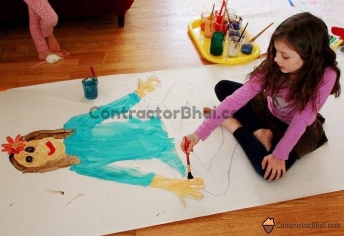 CB-Kid-painting-on -Wooden-flooring