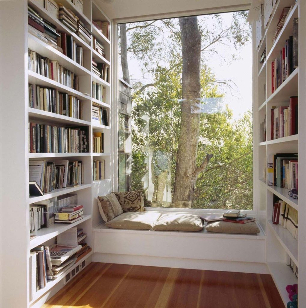 white simple bookcase wedged nook corner